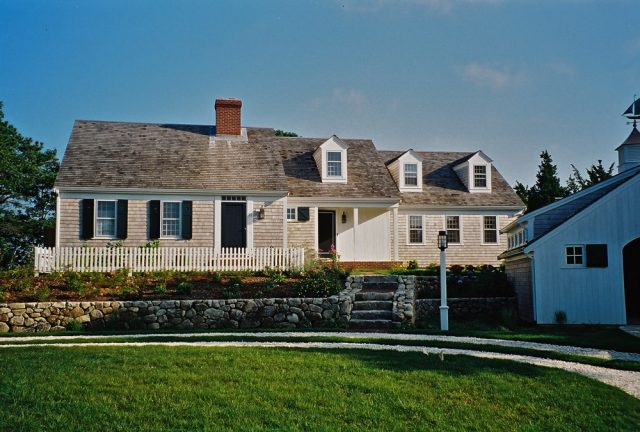 Cape Cod house with doghouse dormers, farmer's porch, entry courtyard, Orleans MA
