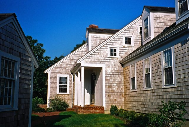 Farmer's porch entry, doghouse dormers, awning windows at gable, traditional Cape Cod house design